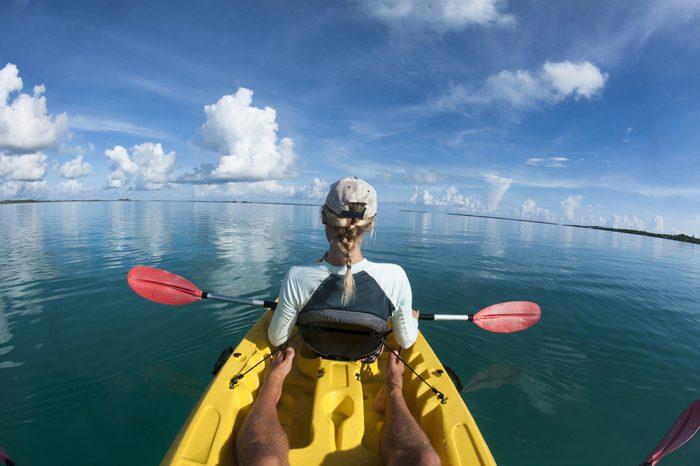 Female in sea Kayak from Behind.