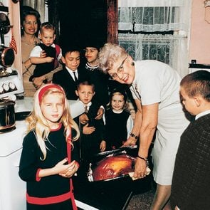 Family cooking turkey.