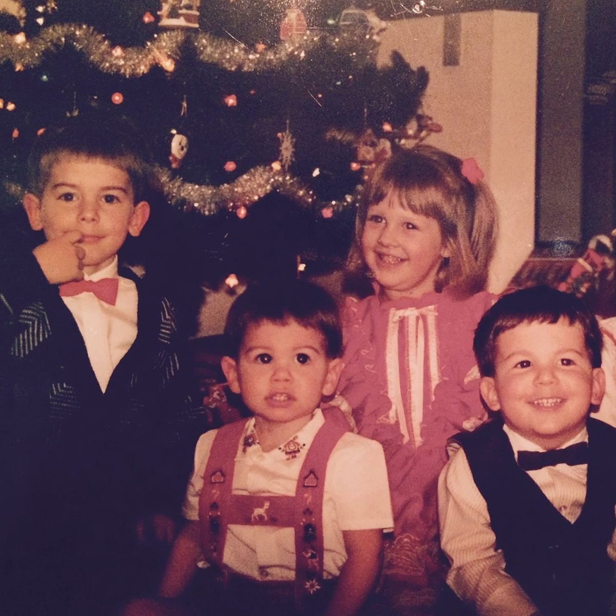 Smiling children all dressed in their Christmas best