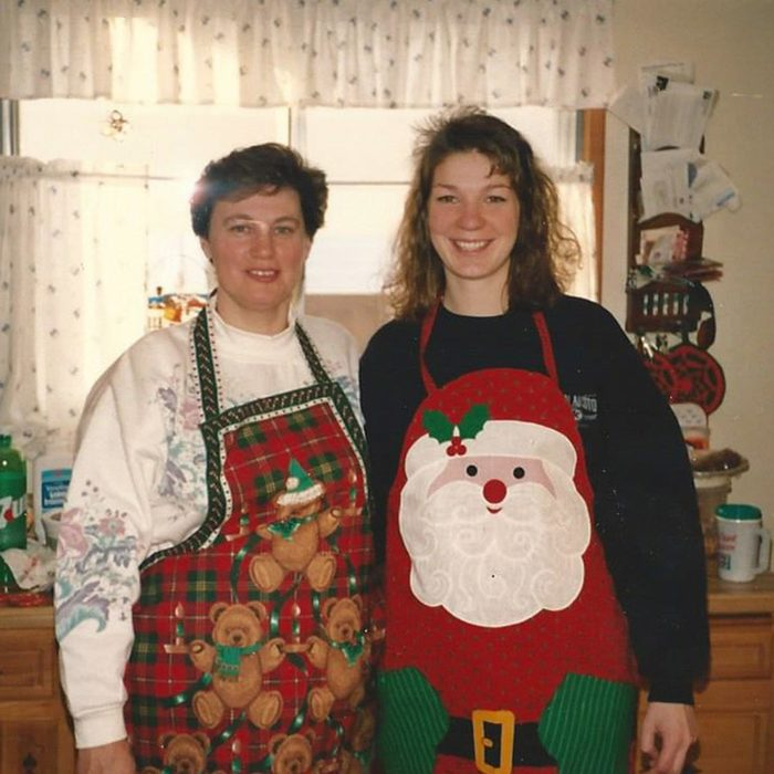 Mother and daughter get ready to bake together in their festive aprons