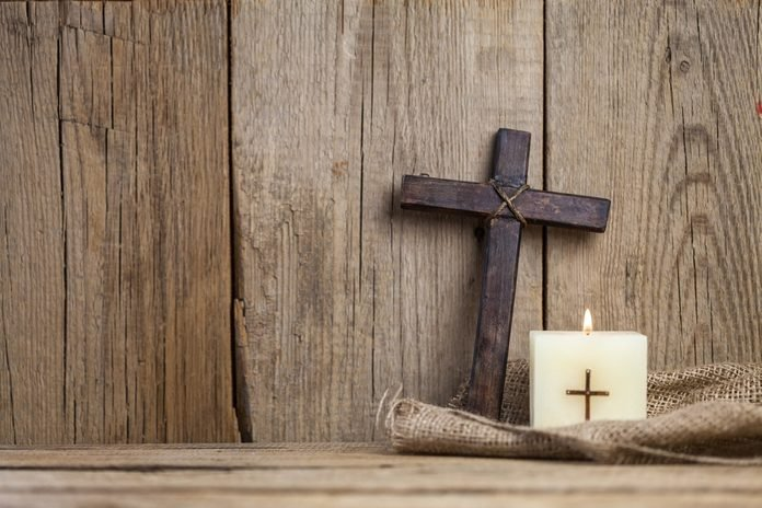 Christian cross and candle.