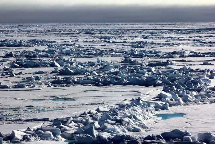 Pack ice near the North pole, hummocky polar ice. Polar day at the lowest position of the sun in late June