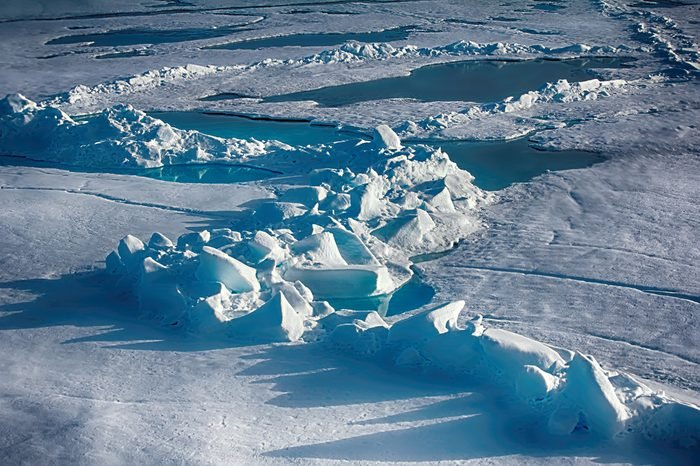 North Pole (88-90 degrees) in 2016. Summer snow morass (melt water pool) and toros (haycock, multi-year ice hummock) on ice of Arctic ocean. Global warming: Ice at North pole will melt in few decades