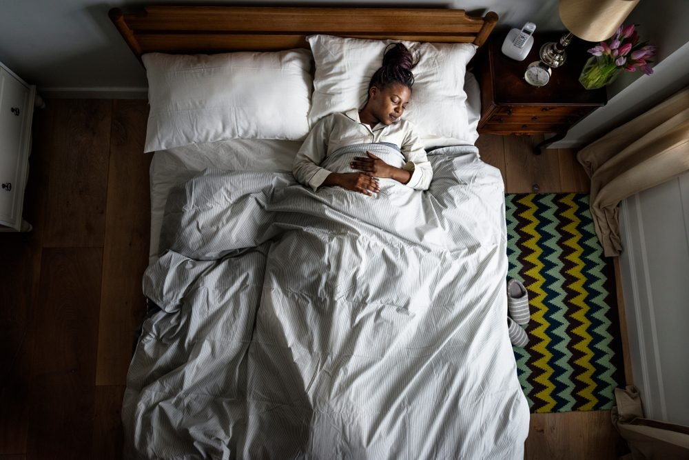 African American woman on bed sleeping