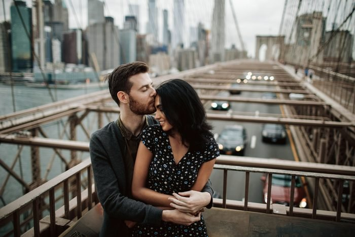 couple kissing on bridge. How to be romantic