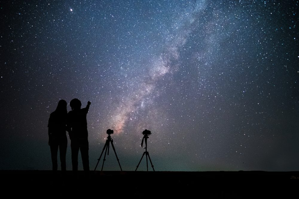 couple looking at stars in sky. Romantic ideas