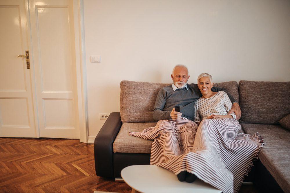 senior couple watching movie. Romantic anniversary ideas