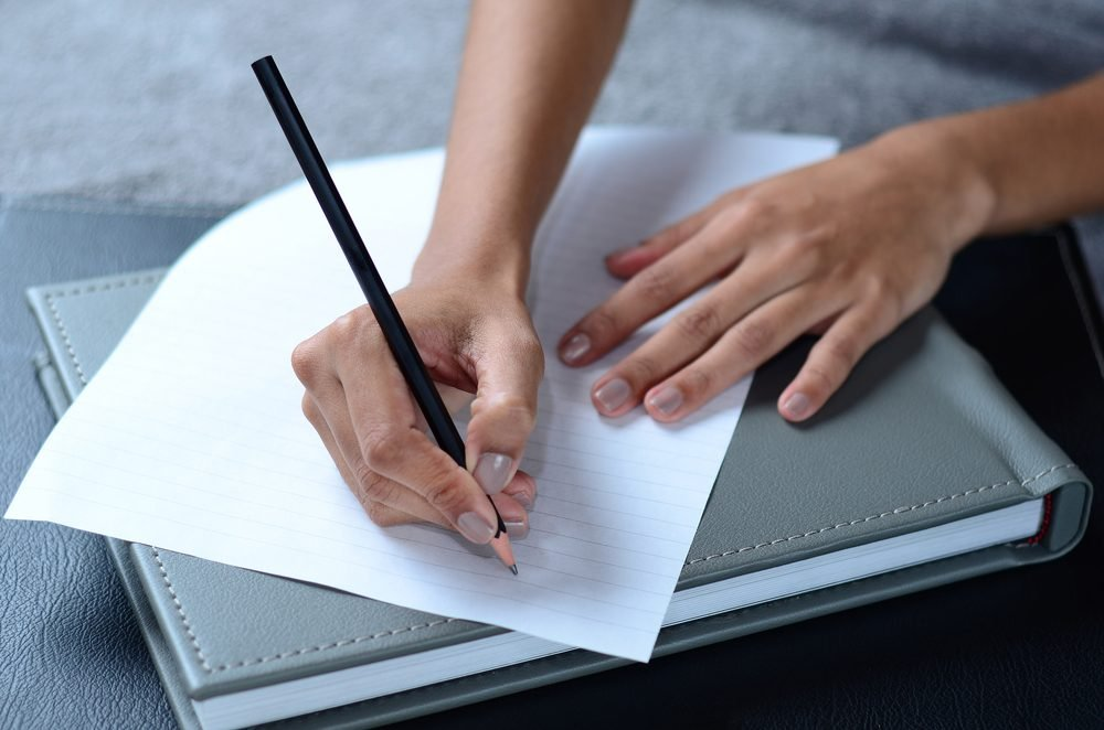 writing a note. Romantic ideas