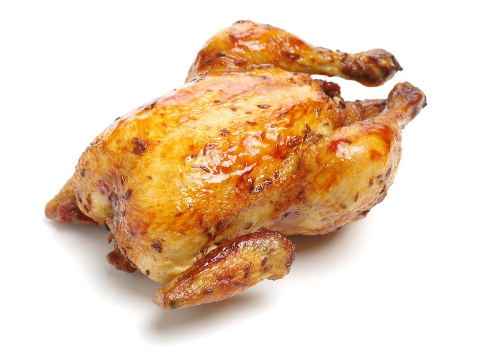 Whole roasted chicken against white background