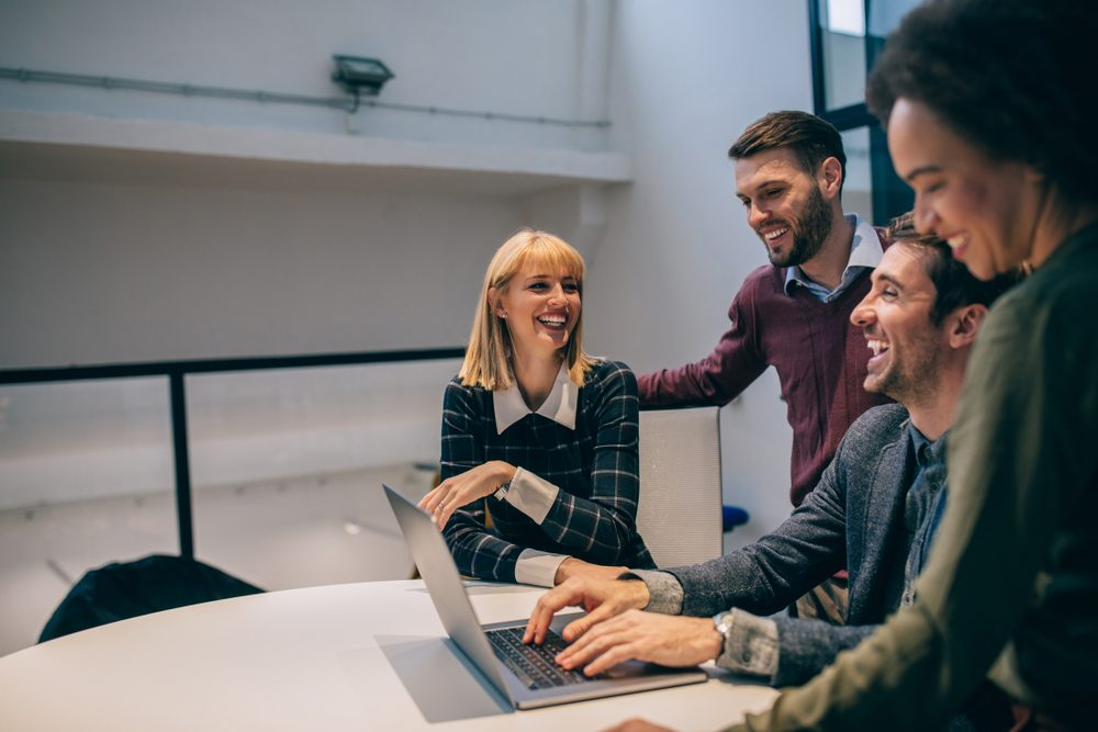 Group of coworkers laughing during a meeting