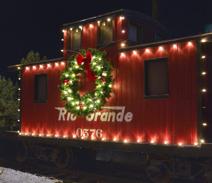 Christmas Railroad Car in Salida; Colorado Why choose a railroad car for a country Christmas contest? Railroads historically played a huge role in the success and development of our valley. The rift valley of the Arkansas River is optimal for ranching with flat expanses over thousands of acres. The river and spring snow melts form the mountains provide the necessary water to support livestock. However; without the railroads; transportation of local ranching products was a perilous endeavor. Given the importance of railroads for the area; Salida celebrates this piece of history with this narrow gauge caboose prominently displayed in a local park. Every year for Christmas the caboose is decorated for all to enjoy.
