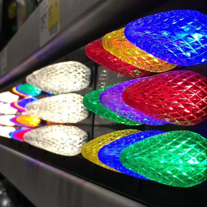 close up of Colorful LED Christmas lights in a line rainbow holiday colors