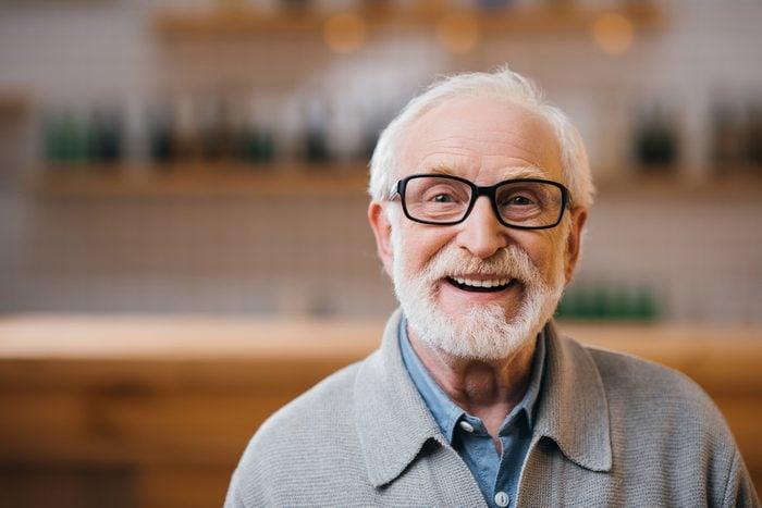 close-up portrait of happy senior man looking at camera