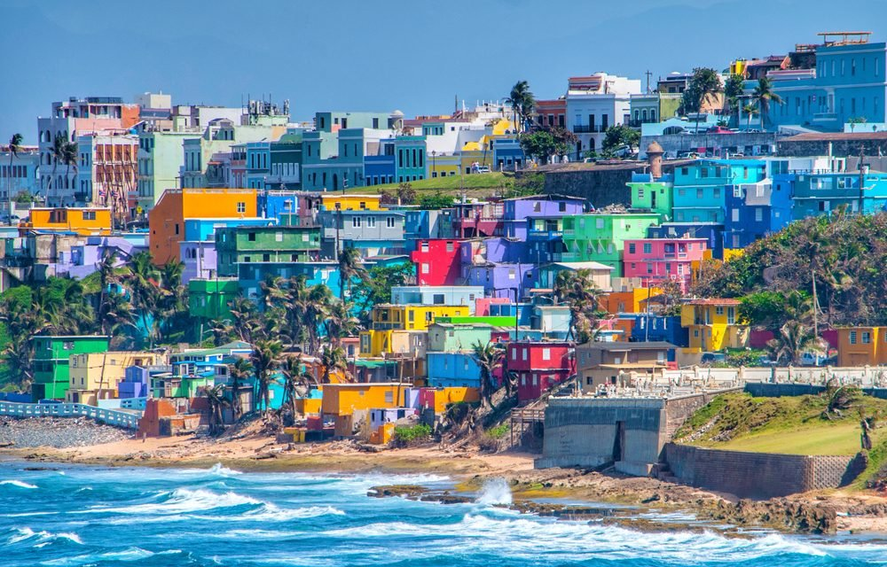 Colorful houses line the hillside over looking the beach in San Juan, Puerto Rico