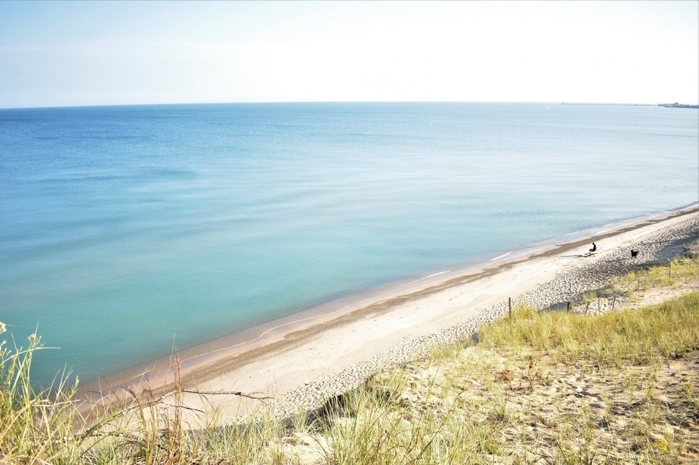 From the top of the Mount Baldy west dune trail, gaze upon the expanse of the great southern Lake Michigan shoreline in Indiana Dunes National Lakeshore Park in Indiana.