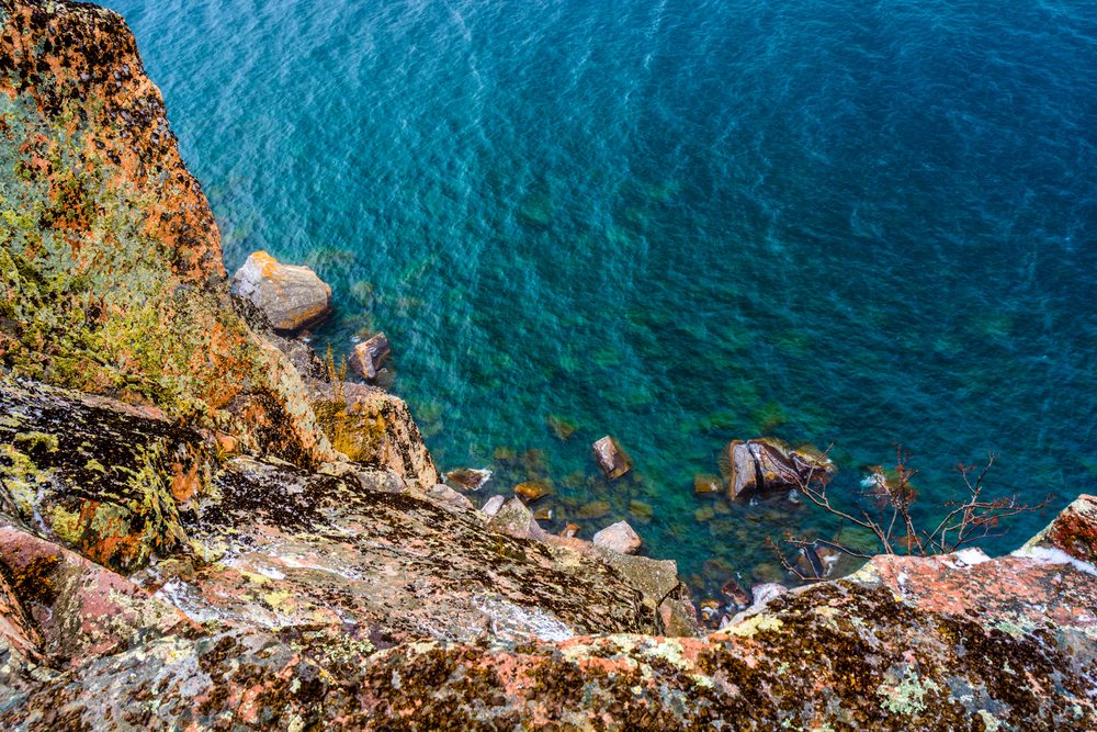 A view looking down the cliff into the beautiful waters of Lake Superior from the Palisade Head Cliffs on the North Shore in Minnesota.