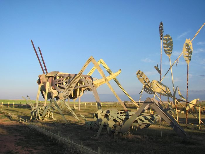 """Regent, ND, USA. December, 2015. A 30-mile stretch of road in western North Dakota is dubbed """"the Enchanted Highway"""" due to its eight oversized folk art sculptures, such as this metal grasshopper."""