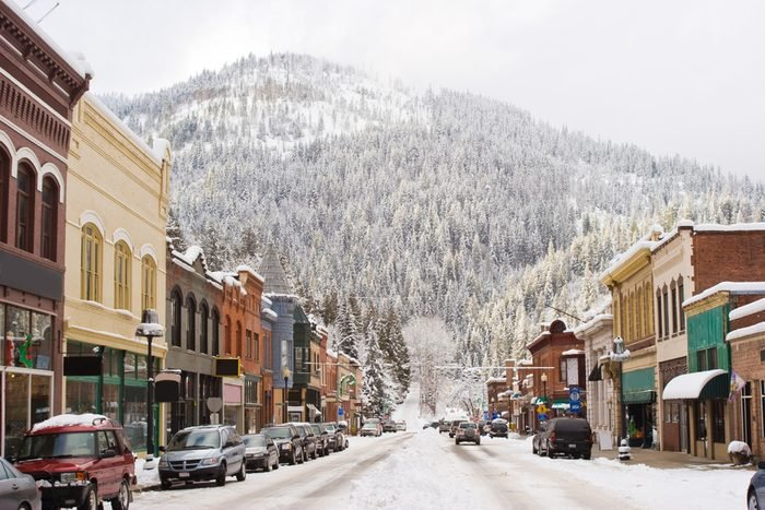 Horizontal Photo of Winter in Downtown Wallace Idaho with snow and mountain in background