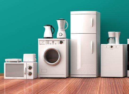 Set of white home appliances on a wooden floor. 3d illustration