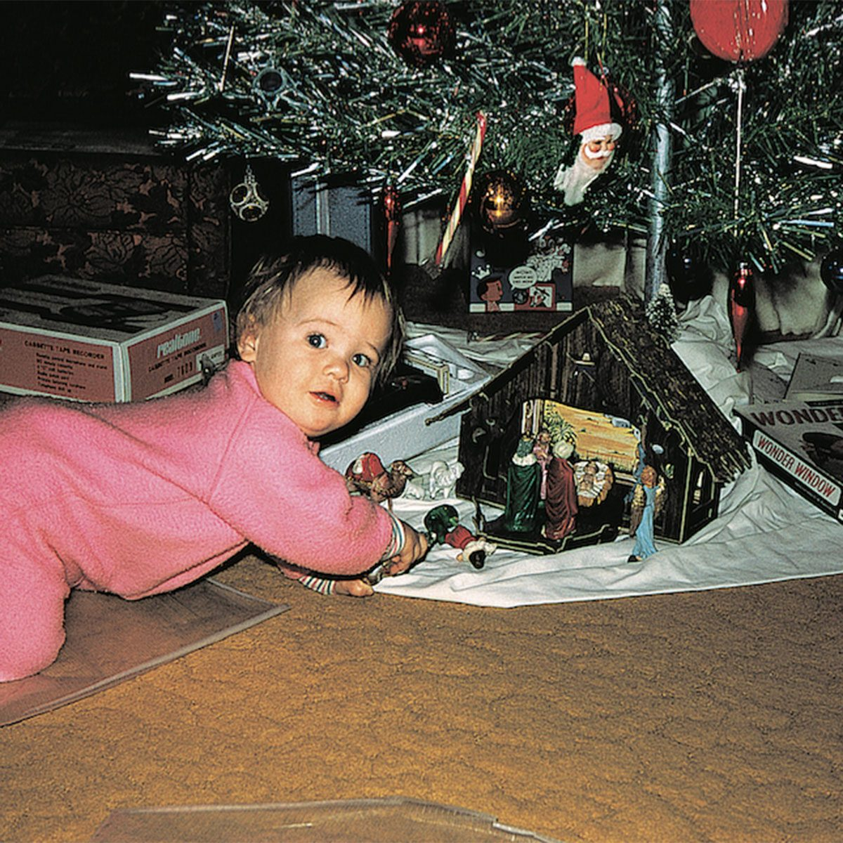Baby calling below the Christmas tree