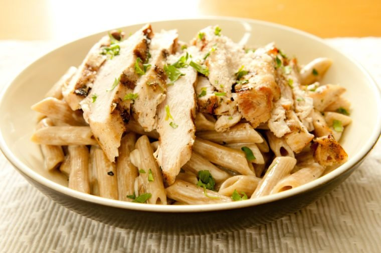 sliced grilled chicken and creamy herbed sauce over penne pasta