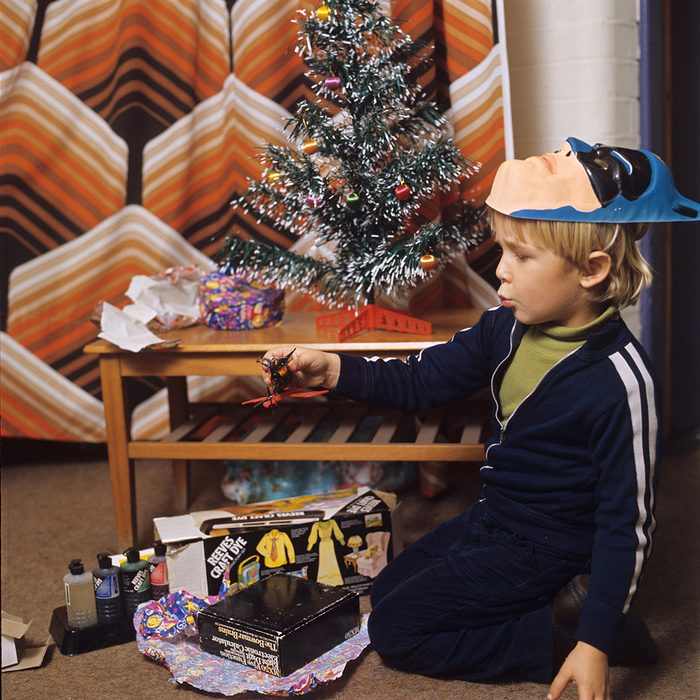 Young boy, Thomas Pietriangeli opening his Christmas presents Father and son opening Christmas presents