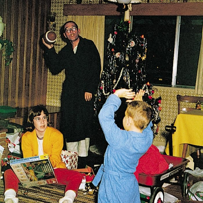 Father and children opening presents on Christmas Day