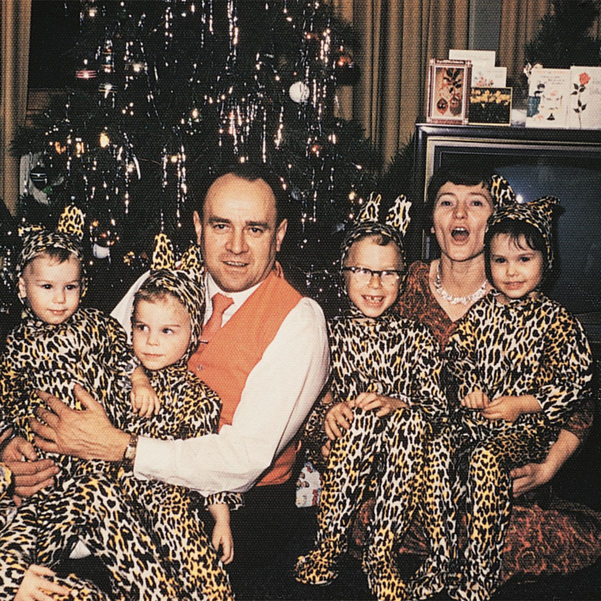 Family posing with matching leopard-print pjs