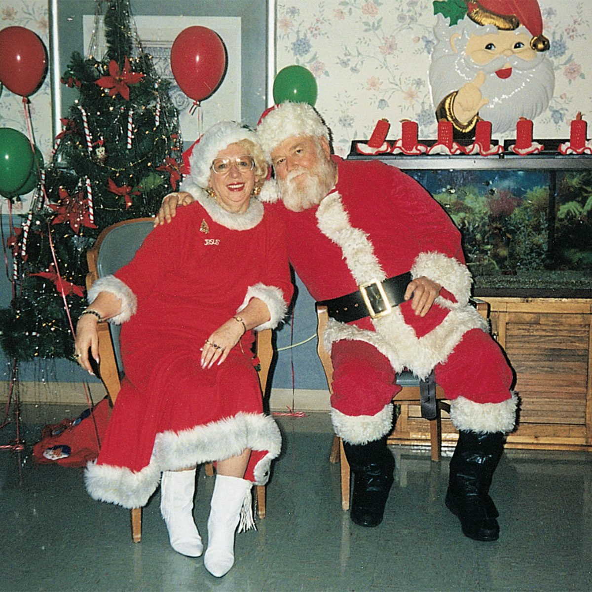 Mr. and Mrs. Claus sitting next to one another