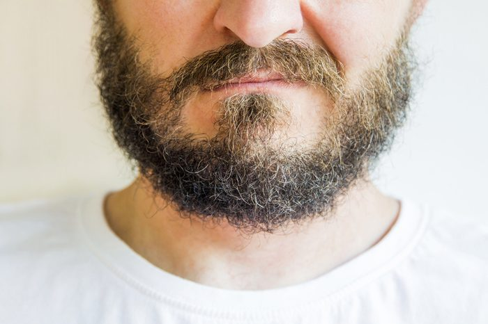 Close up of long beard and mustache man, skeptic expression