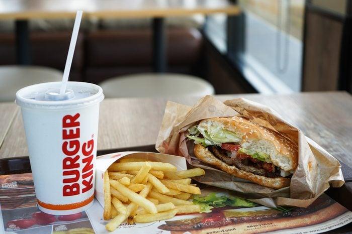 Nakhon Pathom, Thailand - May 10, 2018 : Burger King Cola Cup, Potato french fries and Whopper Hamburger in Burger King restaurant. Burger King is a global chain of hamburger fast food restaurants