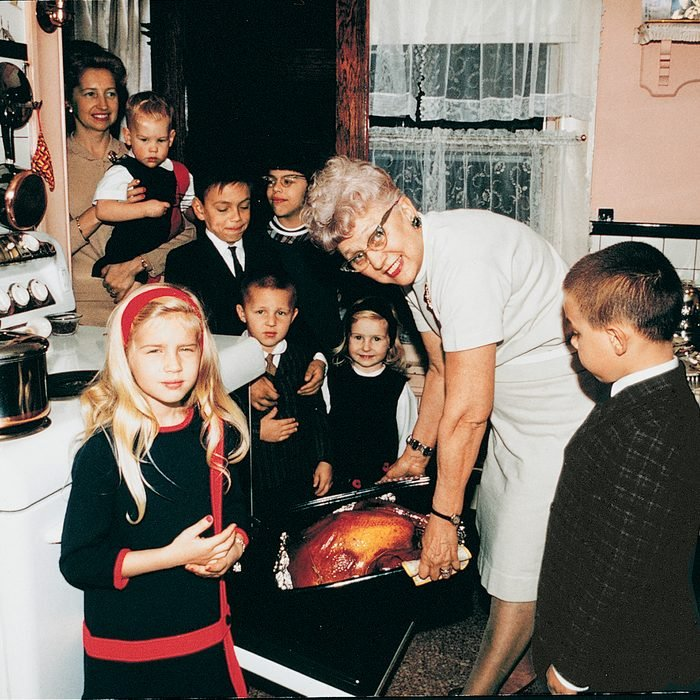 Family cooking turkey