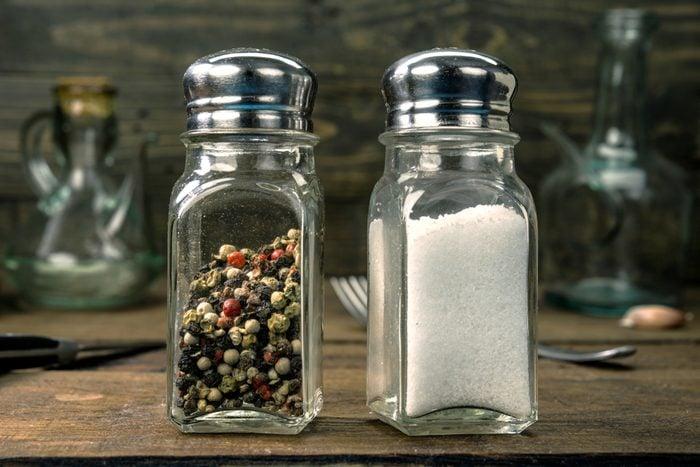 salt and pepper shaker on wooden board