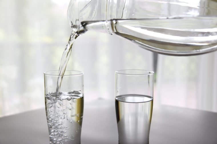 Water pouring into two glasses