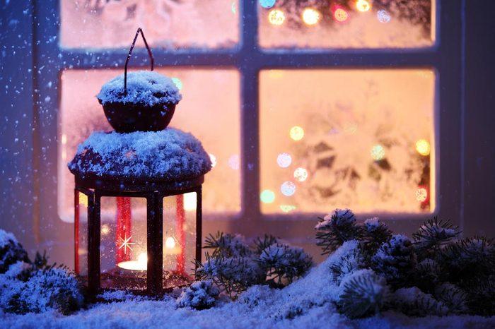 Christmas lantern with snowfall,Closeup.