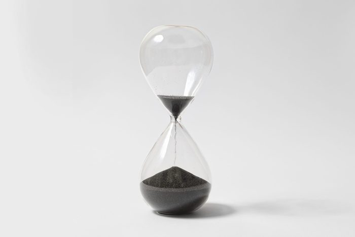 Hourglass On White Background, Running Out Of Time, Black Sand Flowing From Upper Bulb To Lower Bulb Till Deadline; Shutterstock ID 1299531529; Job (TFH, TOH, RD, BNB, CWM, CM): RD