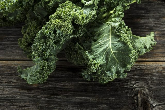 Organic kale with water droplets in closeup