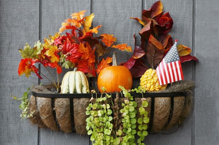 american flag with fall foliage