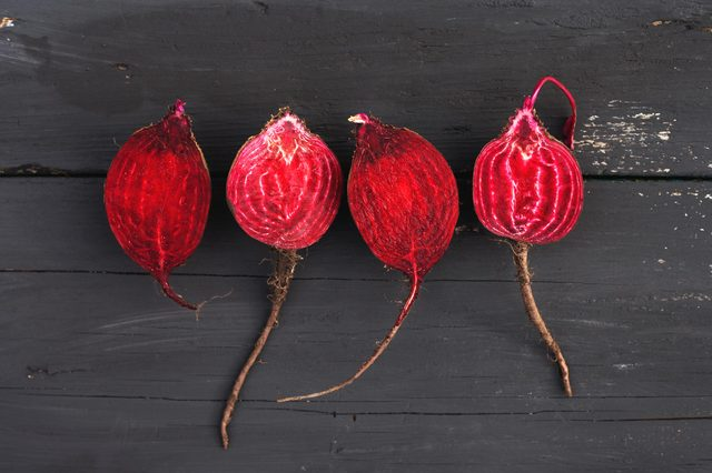 Raw beet on black wooden background.Top view.