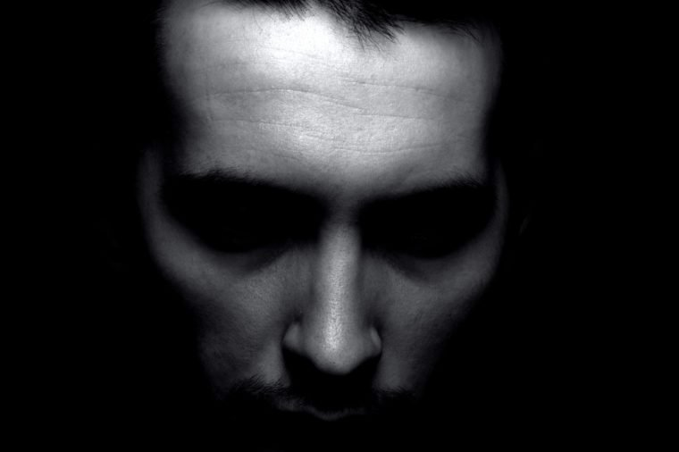 Portrait of man in shadow. Black and white silhouette