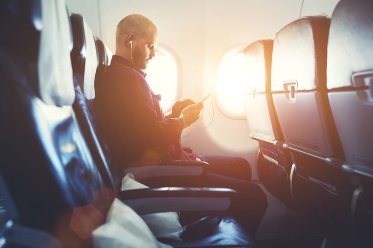 man in airplane seat