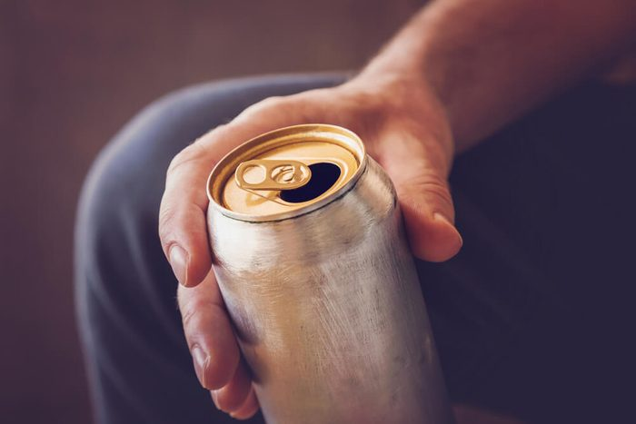 Man drinking a cold beer after work in the evening