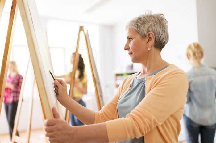 mature woman painting