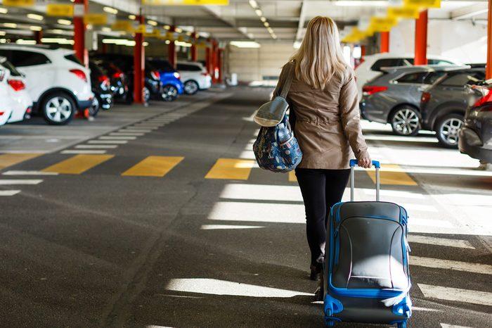 woman parking garage luggage