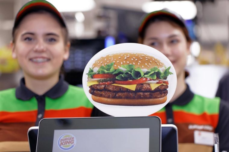ST. PETERSBURG, RUSSIA - NOVEMBER 29, 2017: Staff of 500th Burger King restaurant in Russia in the service area in the day of opening. First Burger King restaurant opened Russia in 2010