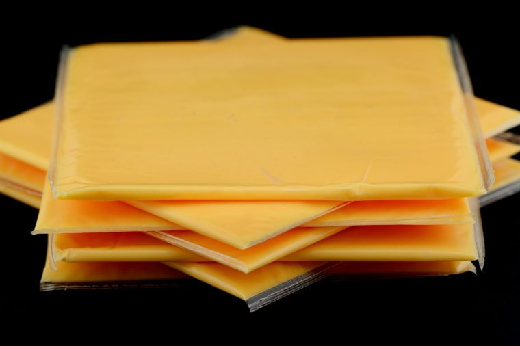 Several slices of american cheese in the studio