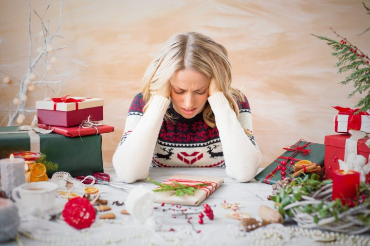 Woman depressed with Christmas gift clutter
