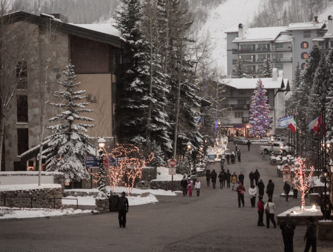 Landscape view of the streets in Vail, Colorado with the ski resort in the background during winter.