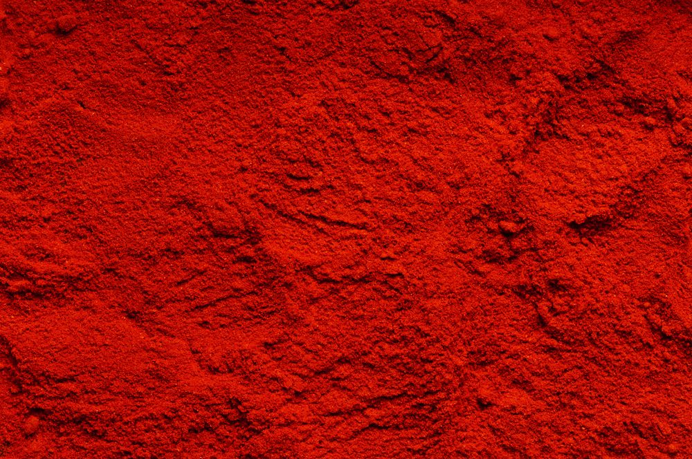 Red chili powder (the background)