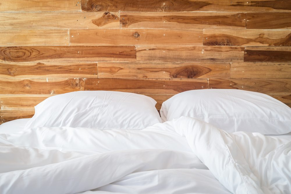 Close up white bedding sheets and pillow, Messy bed concept